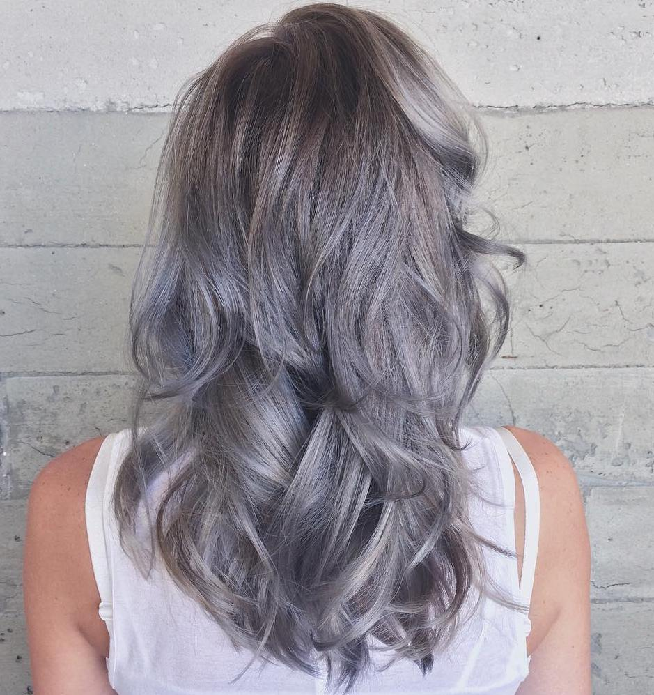 Long Curly Layered Gray and Pastel Purple Hairstyle