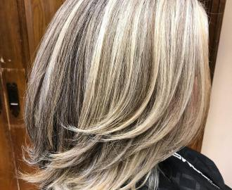 mid-length gray blonde hairstyle with long layers