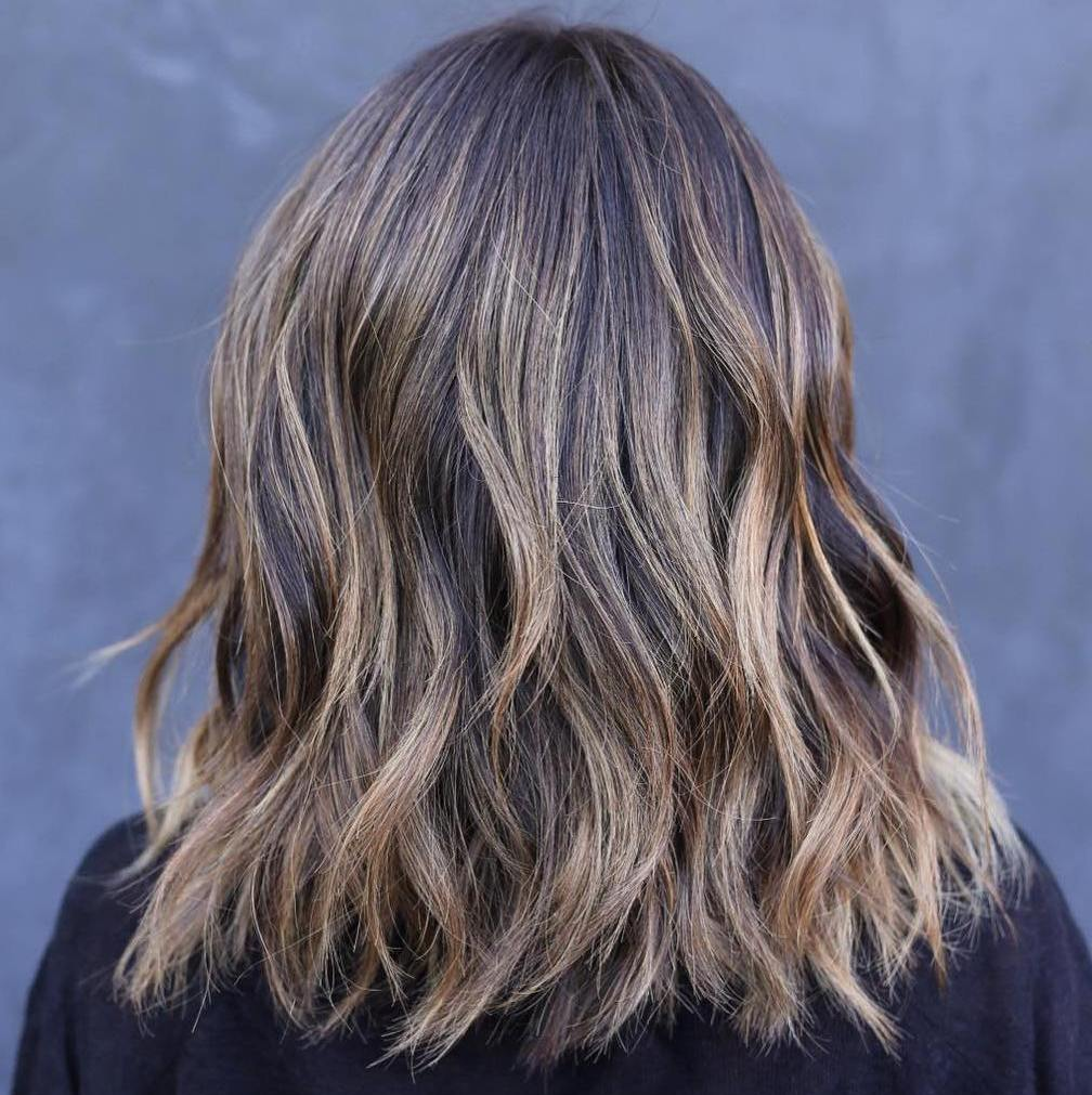 Medium Wavy Cut with Sun-Kissed Highlights