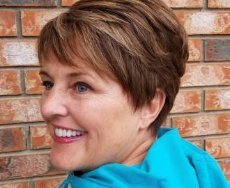 brown layered pixie over 50