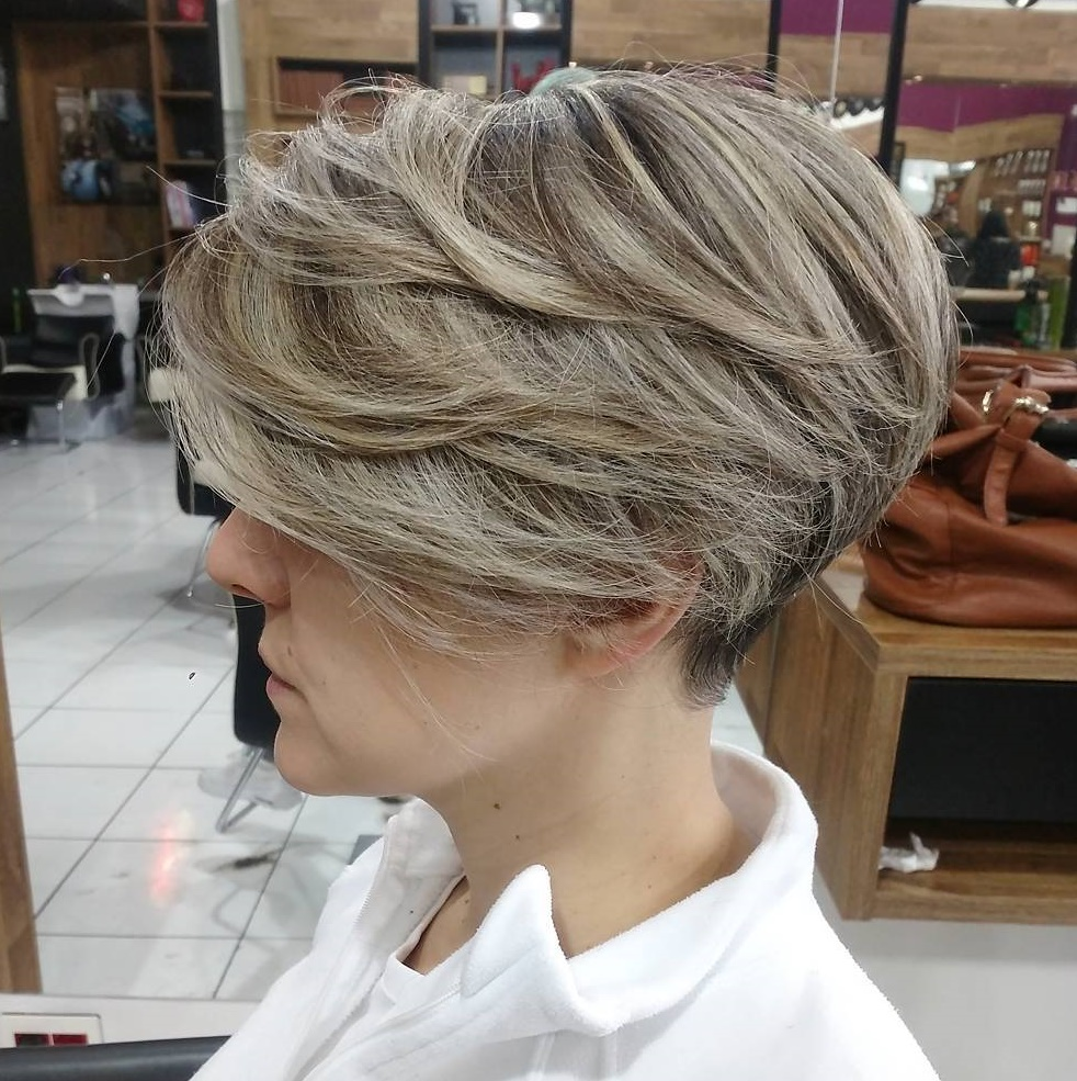 Short Feathered Haircut with Bangs for Thick Hair