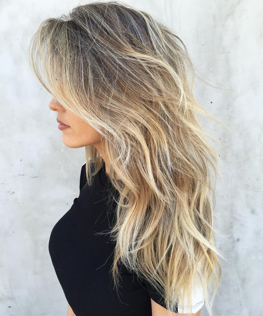 Long Wavy Layered Blonde Hairstyle