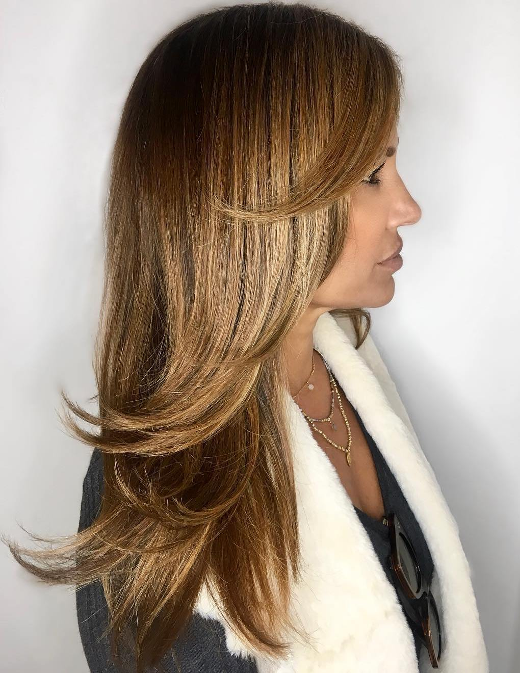 Long Cut with Angled Bangs and Swoopy Layers