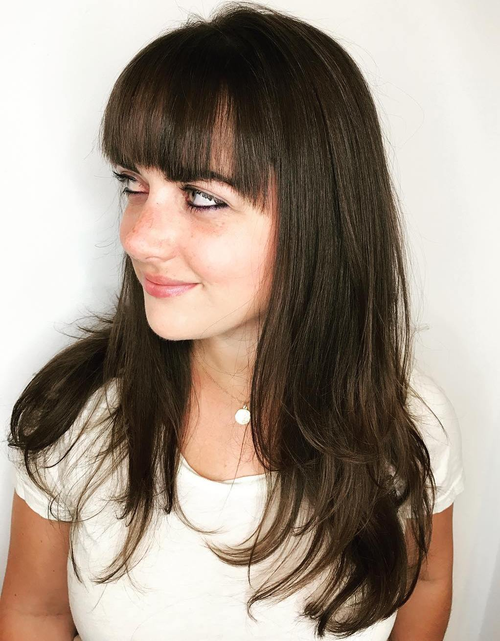 Long Hair with Jagged Bangs and Layered Ends
