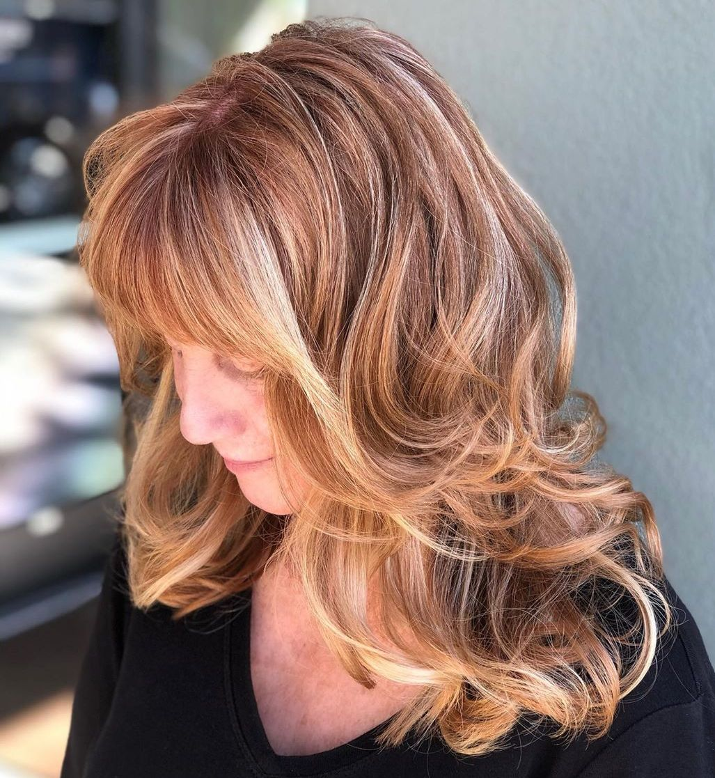 Curled Hairstyle with Long Layers and Bangs