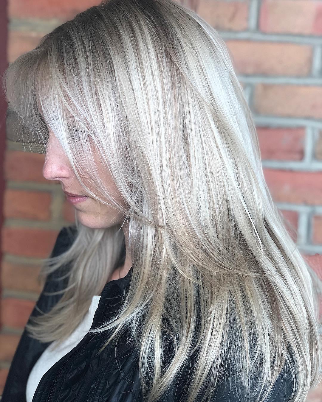 Cool Blonde Balayage Hair with Bangs