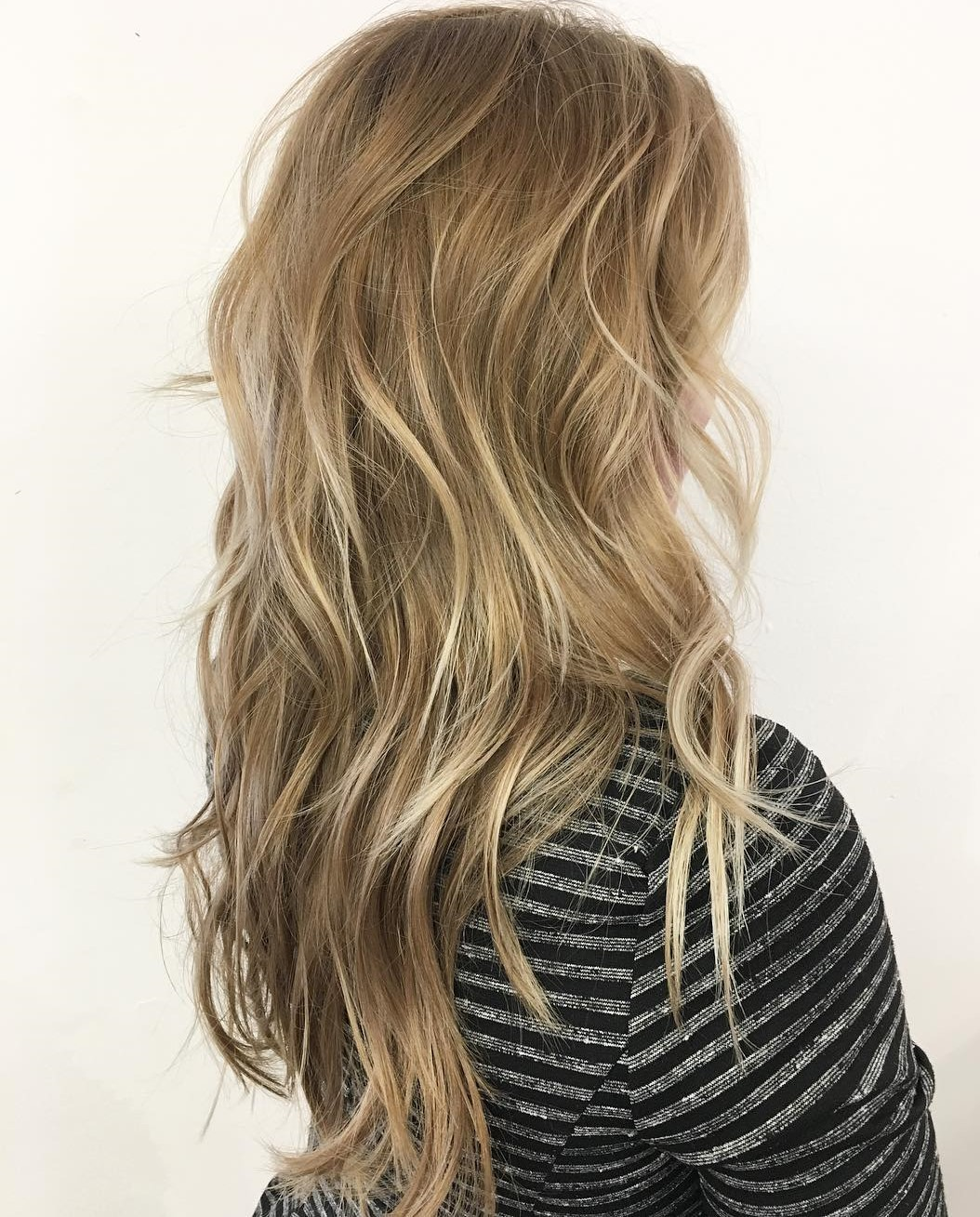 Long Layered Blonde Haircut with Highlights