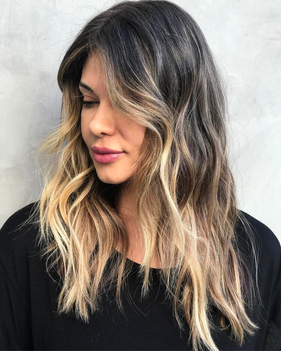 Wavy Shaggy Face-Framing Long Hairstyle