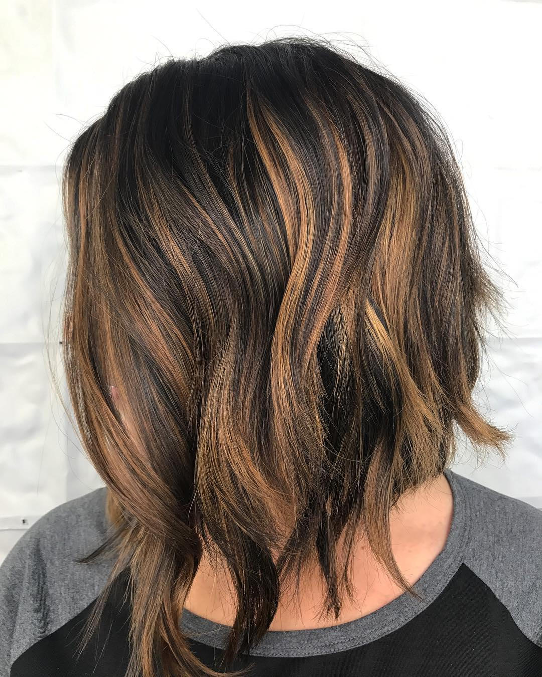Inverted Razored Brunette Bob with Highlights