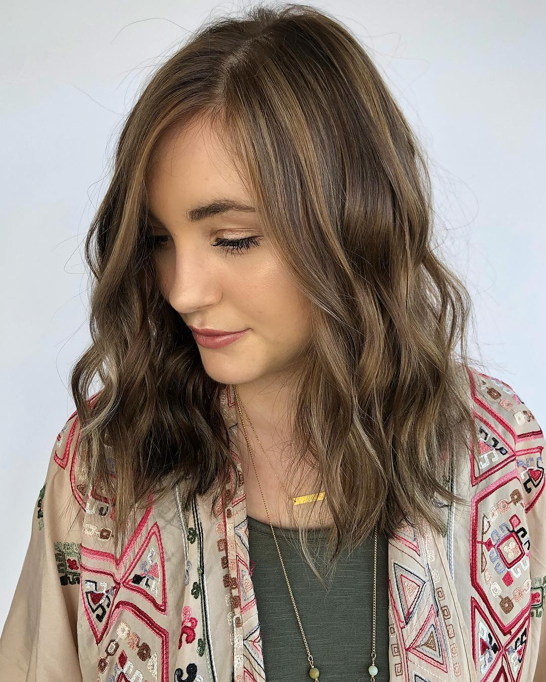 Medium Brunette Hairstyle with Light Brown Highlights