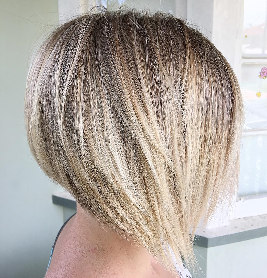 Sleek Angled Blonde Balayage Bob