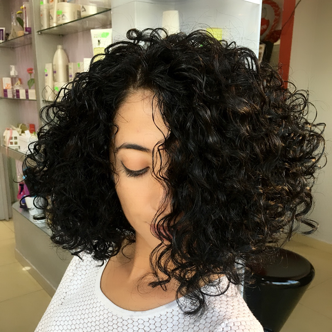 Curly Asymmetrical Perm Bob