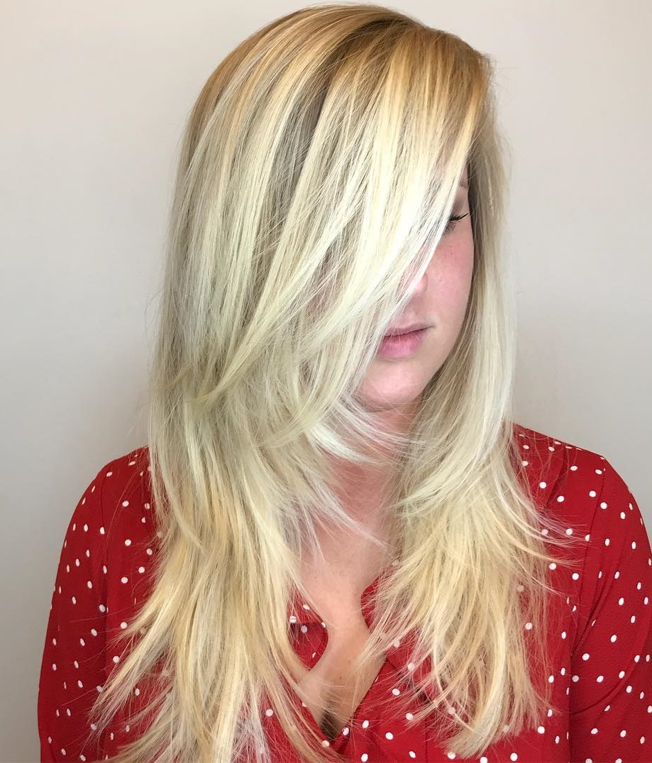 Platinum Blonde Long Feathered Haircut