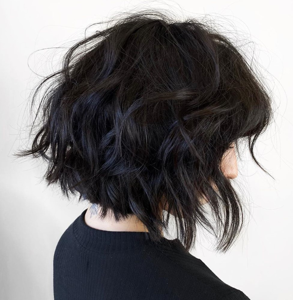 Neck-Length Curly Cut with Messy Layers