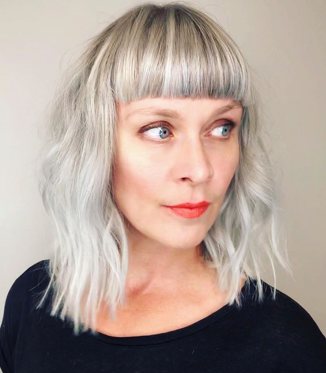 Medium Haircut with Straight-Across Bangs