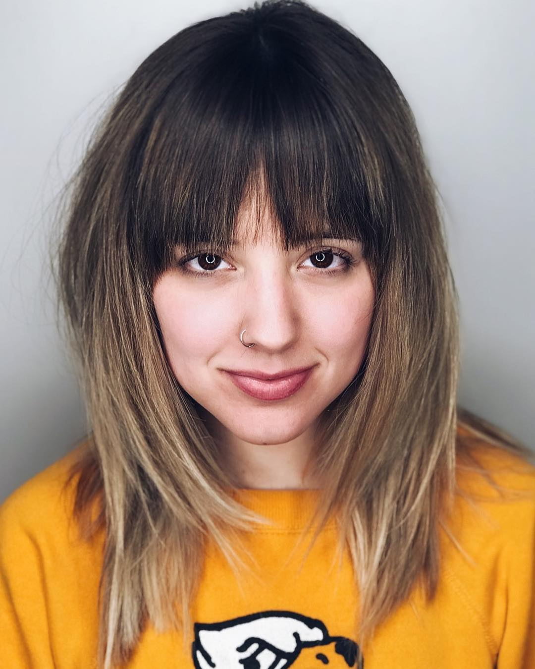 Mid-Length Textured Haircut with Bangs