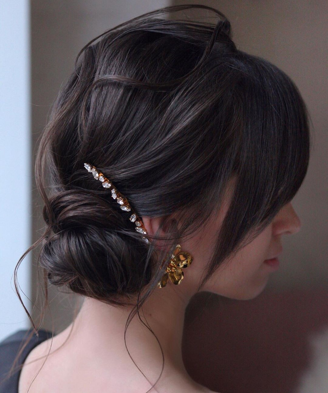 Messy Low Updo with Bangs