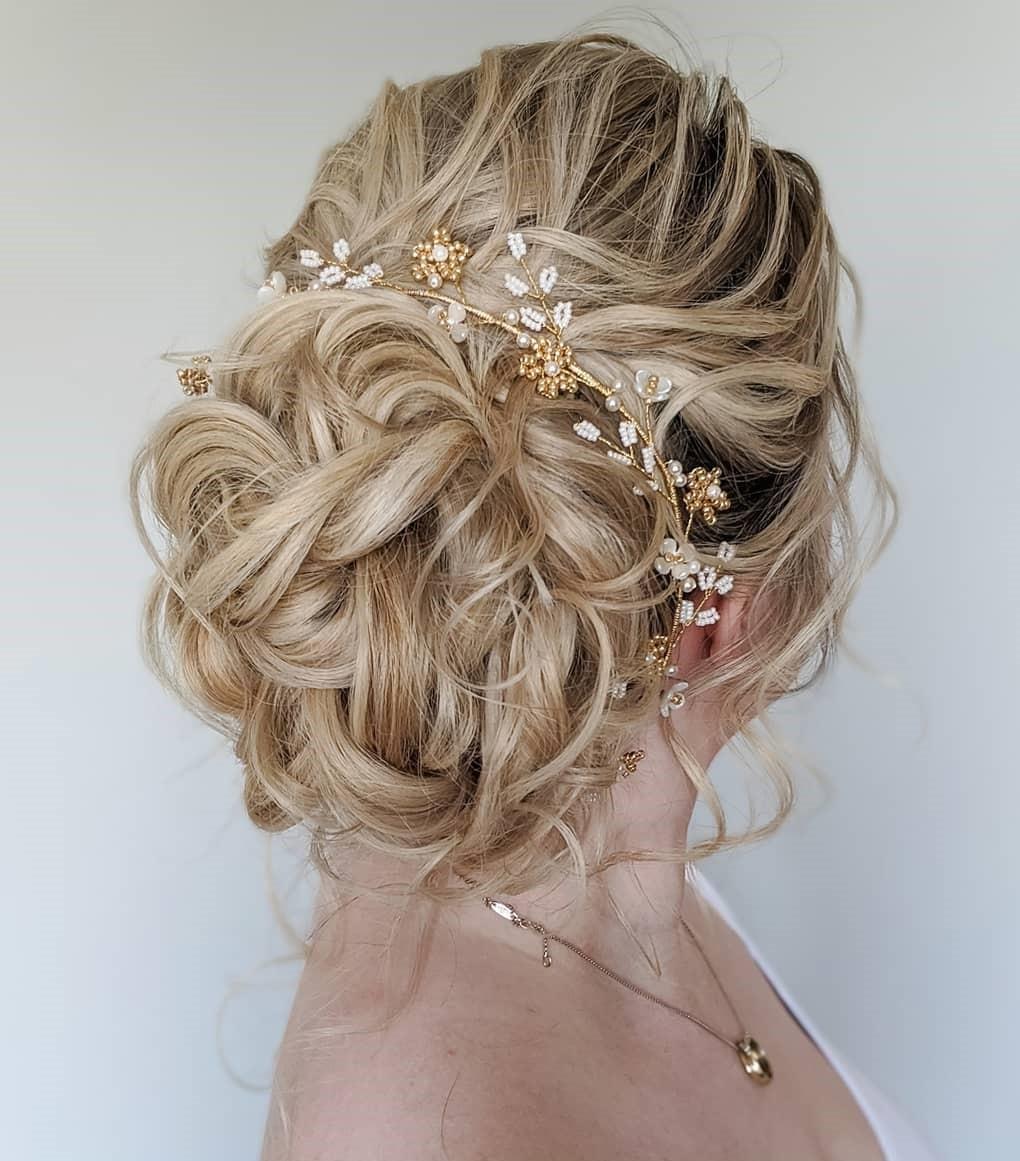 Elegant Messy Wavy Updo Hairstyle