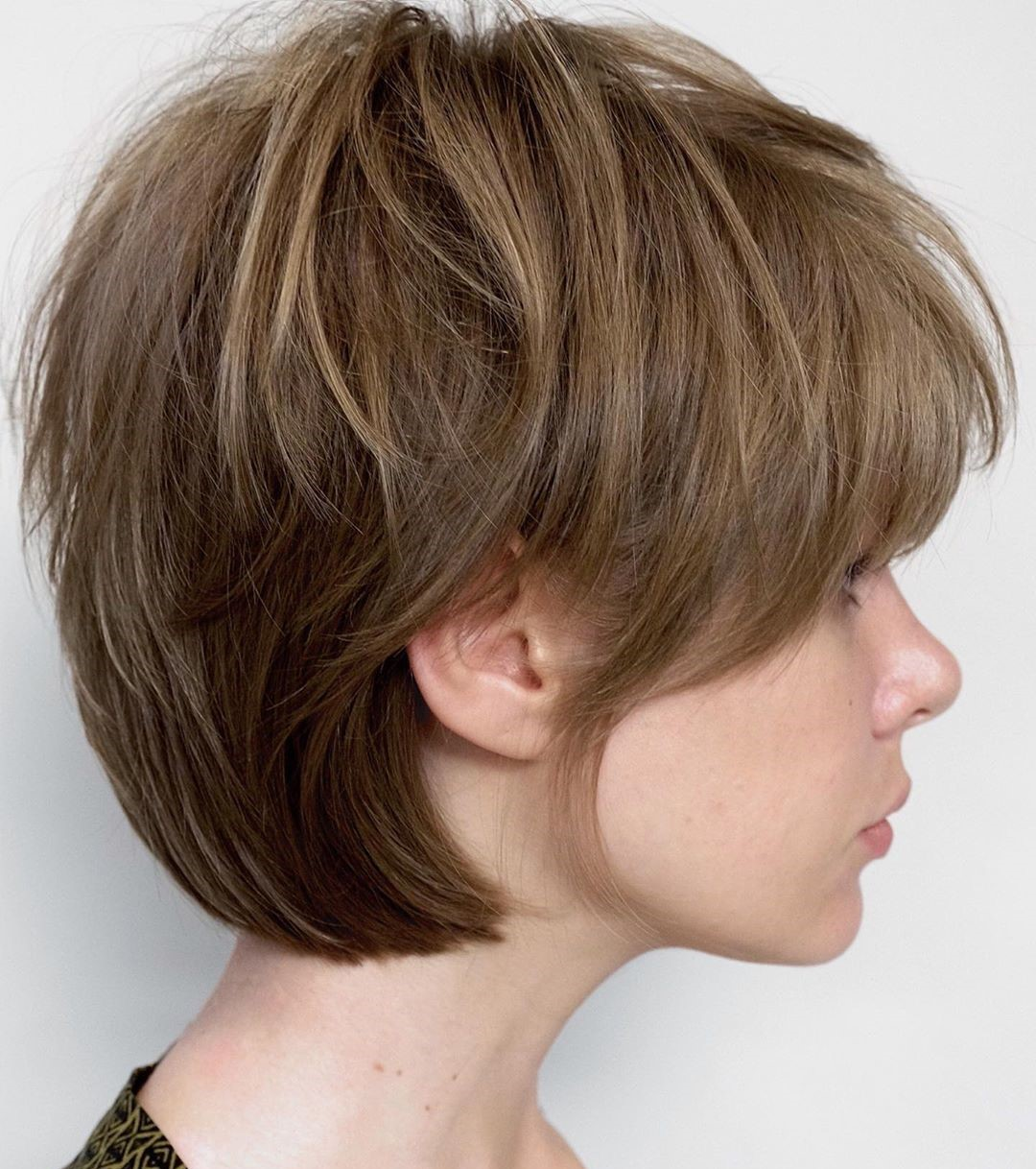 Women's Textured Short Hairstyle with Bangs