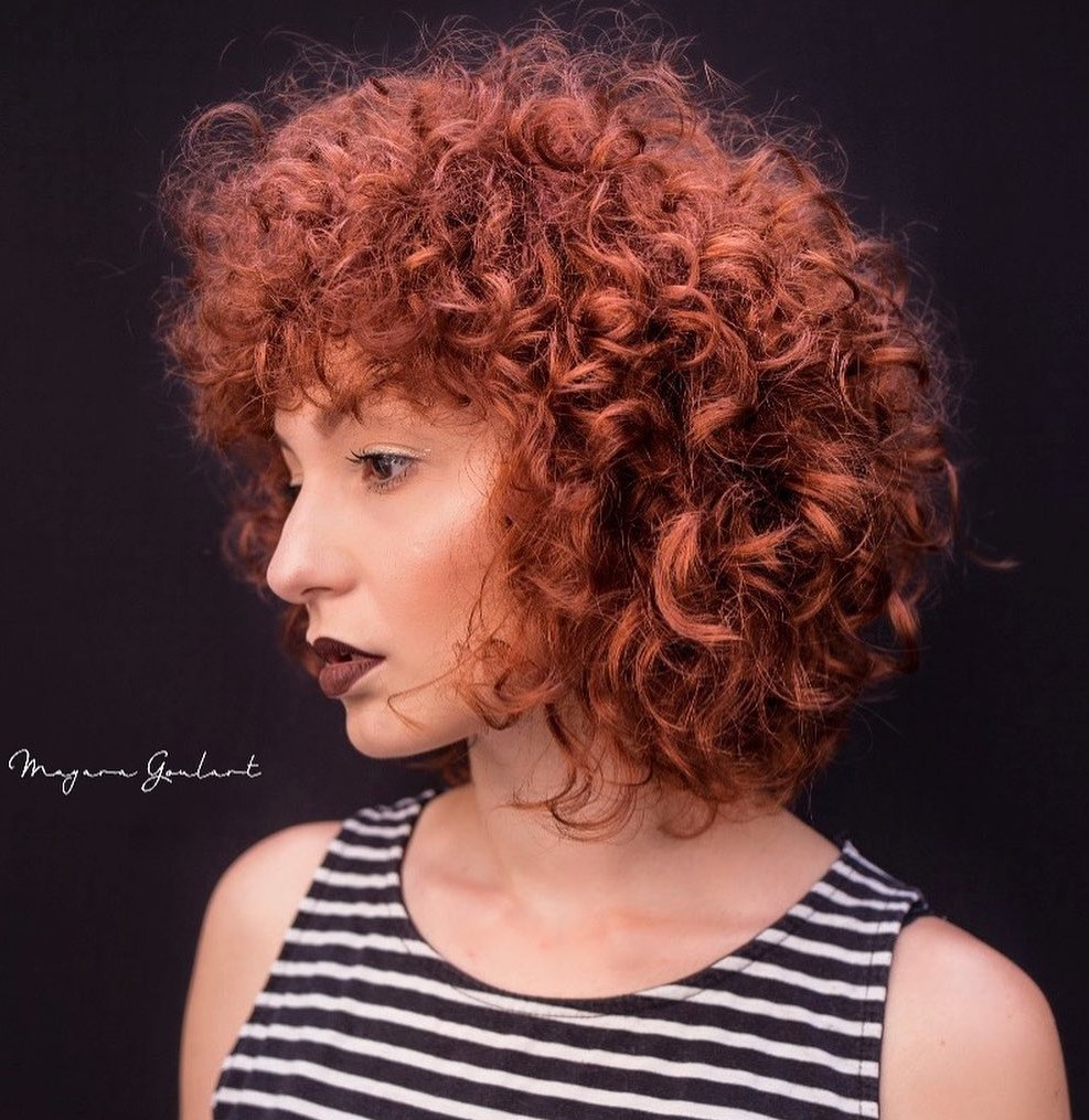 Medium Curly Auburn Hairstyle