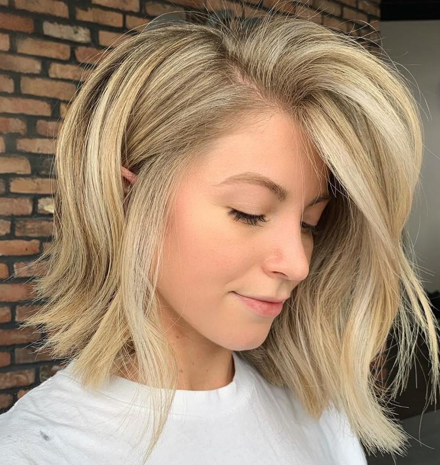 Voluminous Beige Blond Balayage Hair
