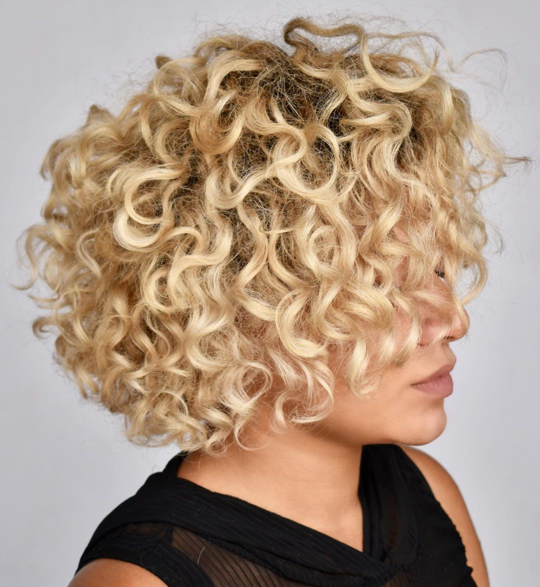 Curly Blonde Hair for Tanned Skin
