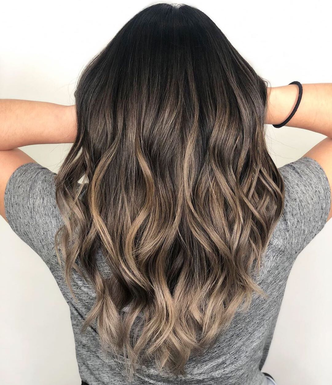 Dark Curly Hair with Ash Blonde Highlights