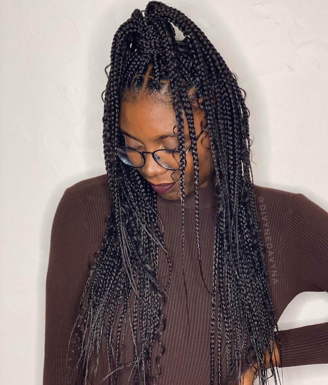 Messy Curly Box Braids in a Pony