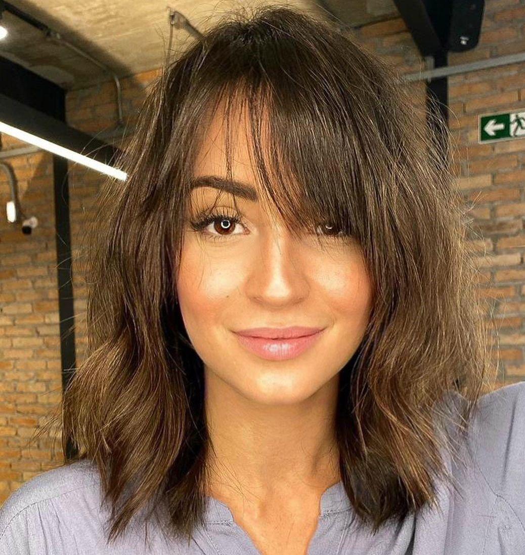 Shoulder-Length Shaggy Haircut with Bangs