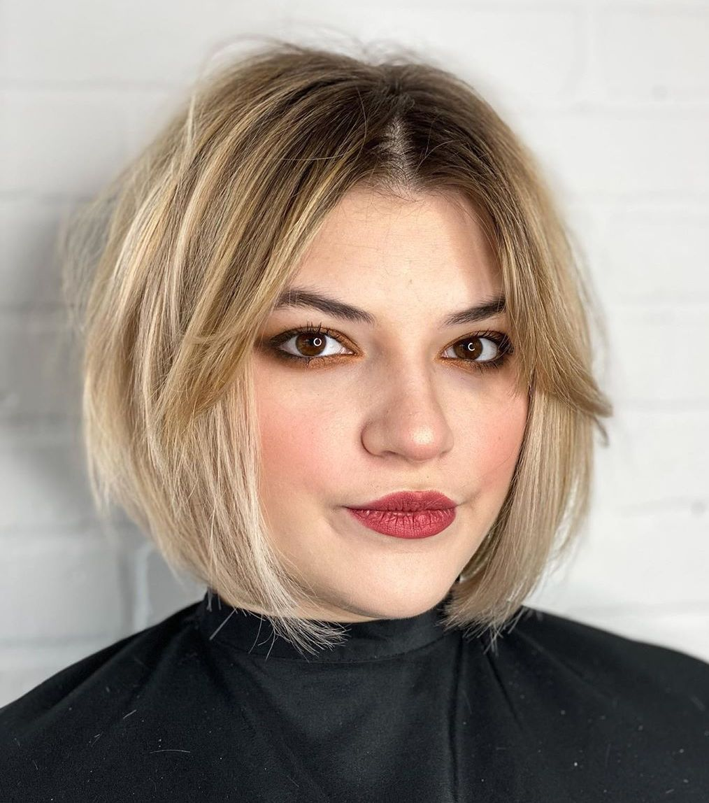 Short Blonde Balayage Bob with Bangs