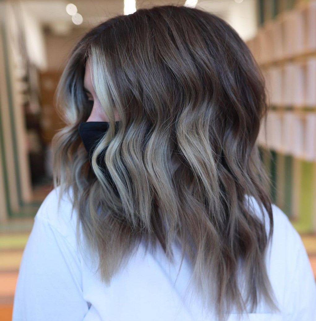Thick Shoulder-Length Hairstyle with Layers