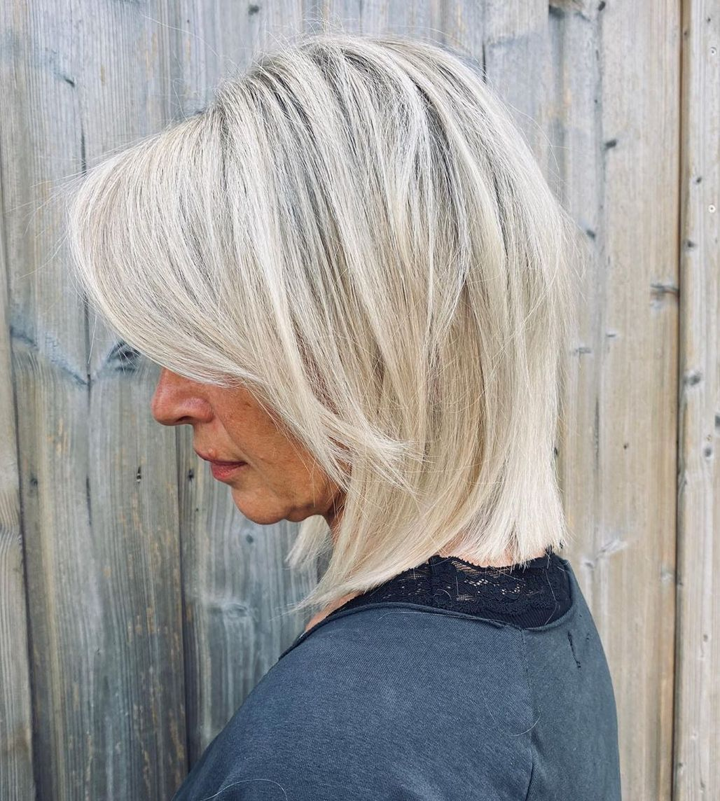 Medium Blonde Hairstyle for Women over 50 with Thick Hair
