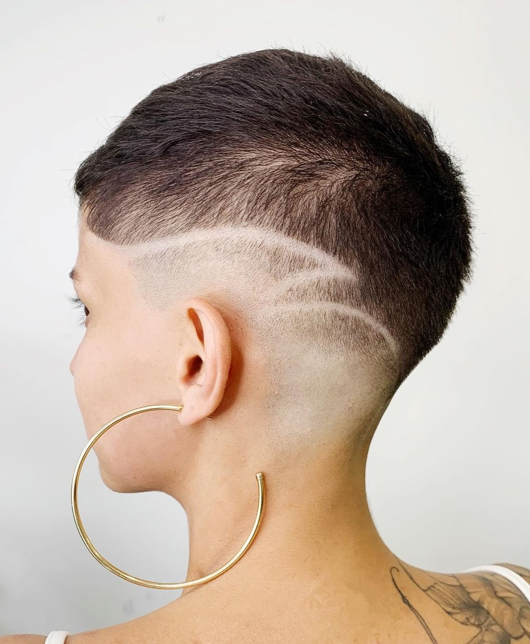 Female Fade with Shaved Design
