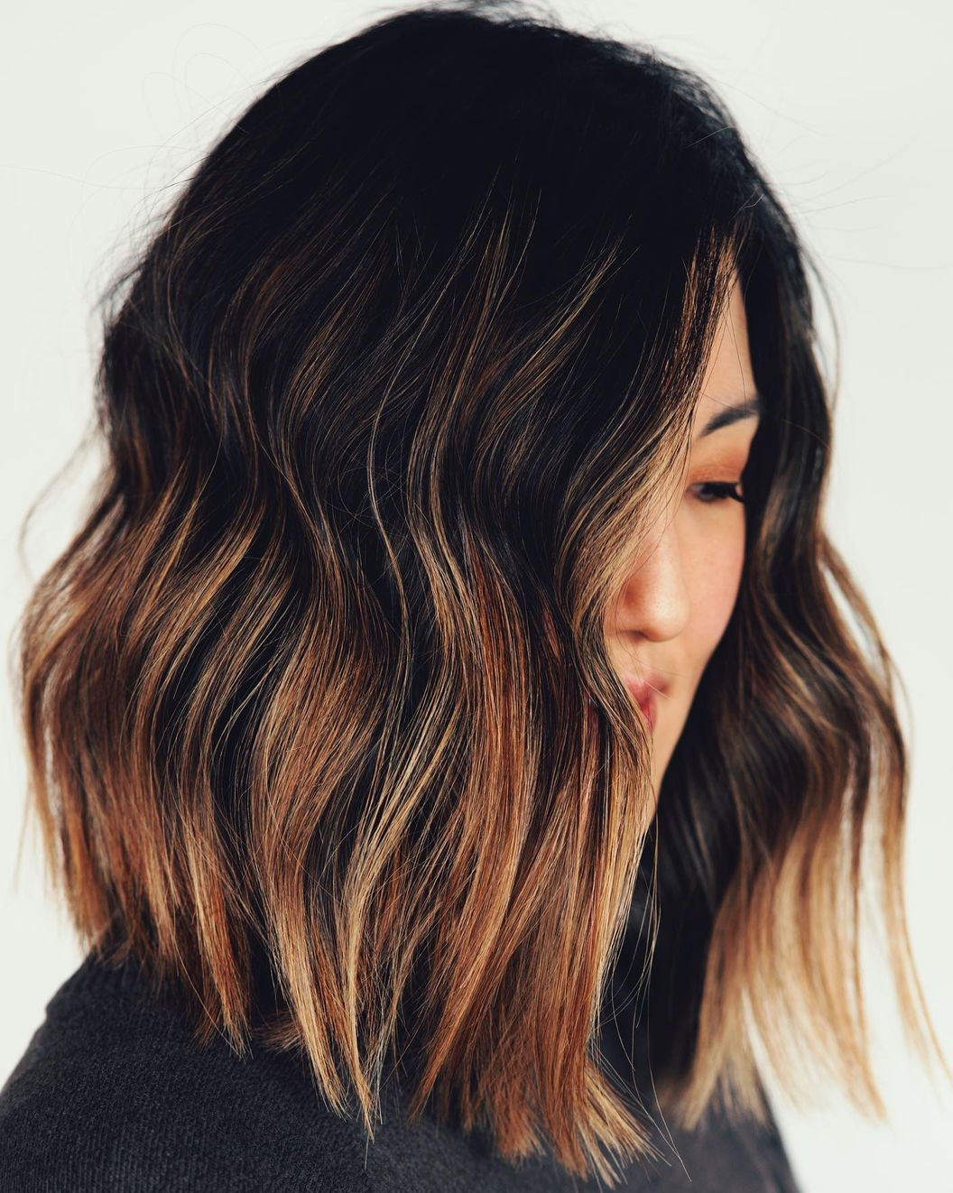 Black Hair with Midshaft Golden Brown Highlights