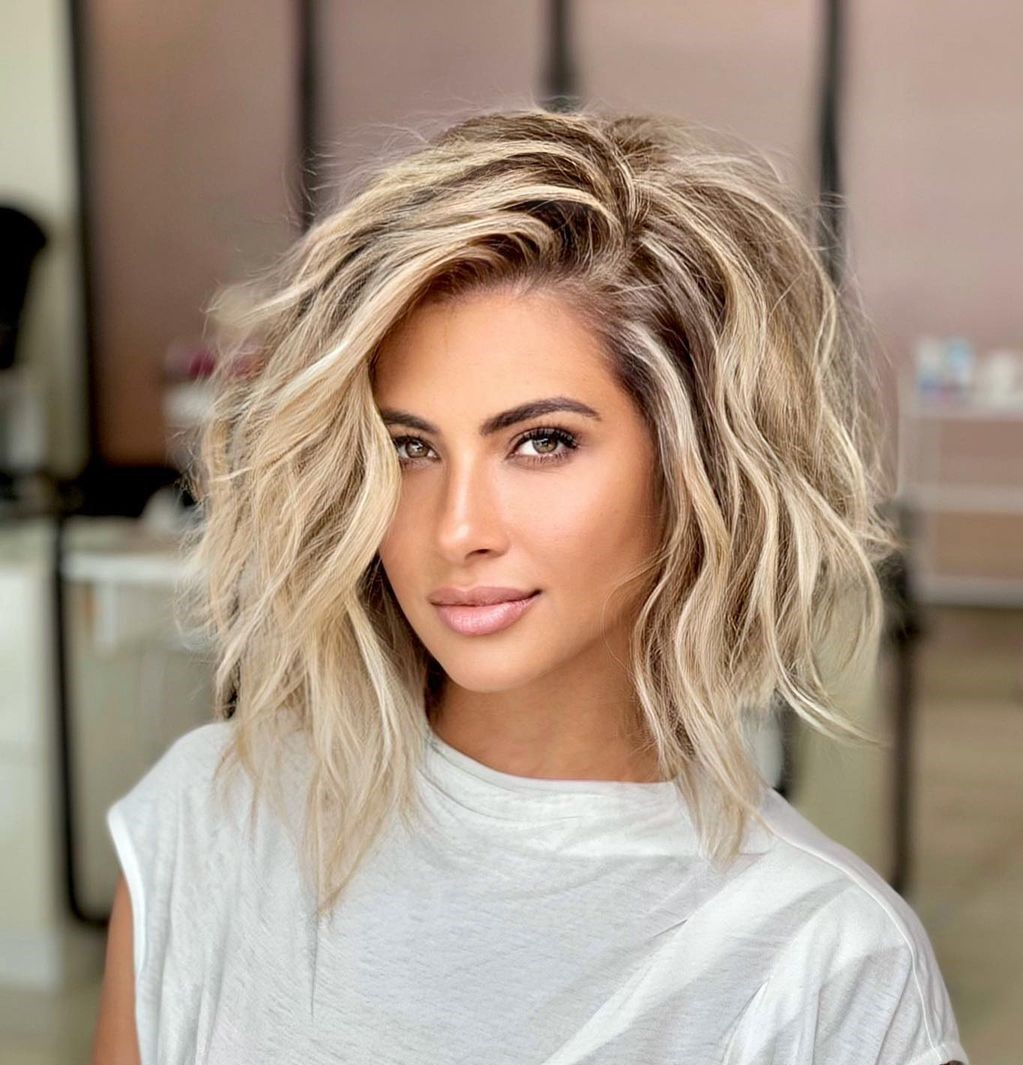 Wavy Blonde Hair with Highlights