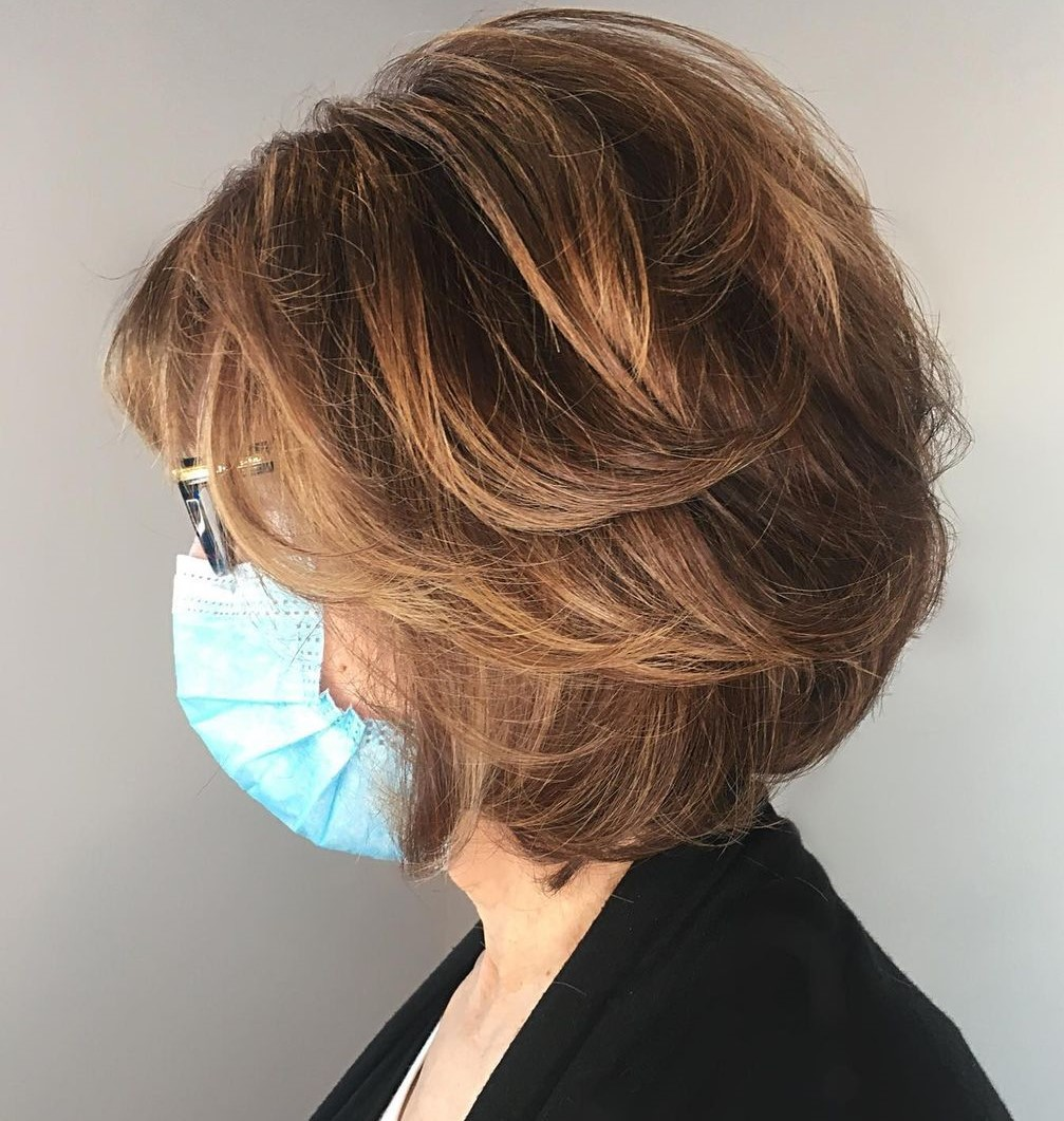 Over 50 Feathered Midi Cut for Thick Hair