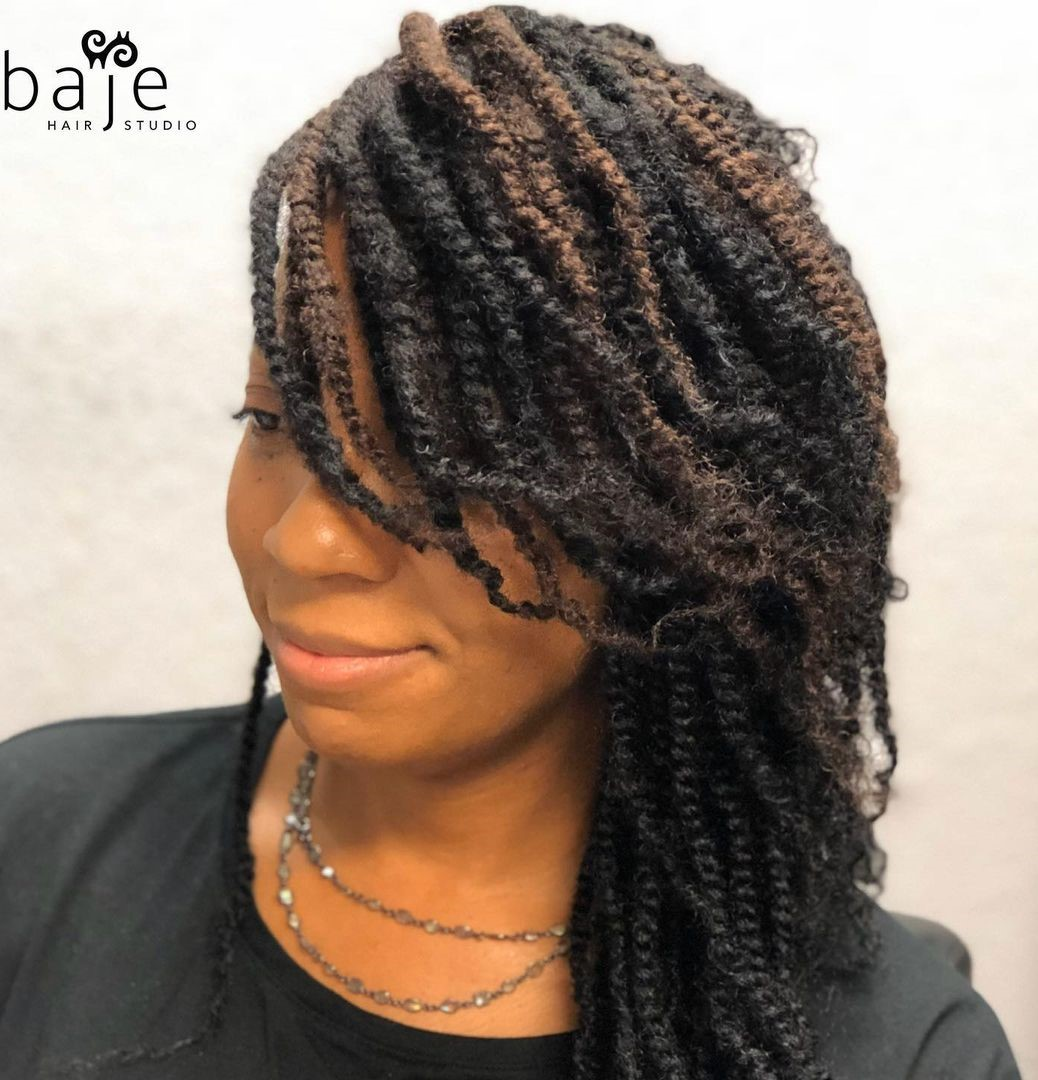 Kinky Twists with a Side Part and Bangs