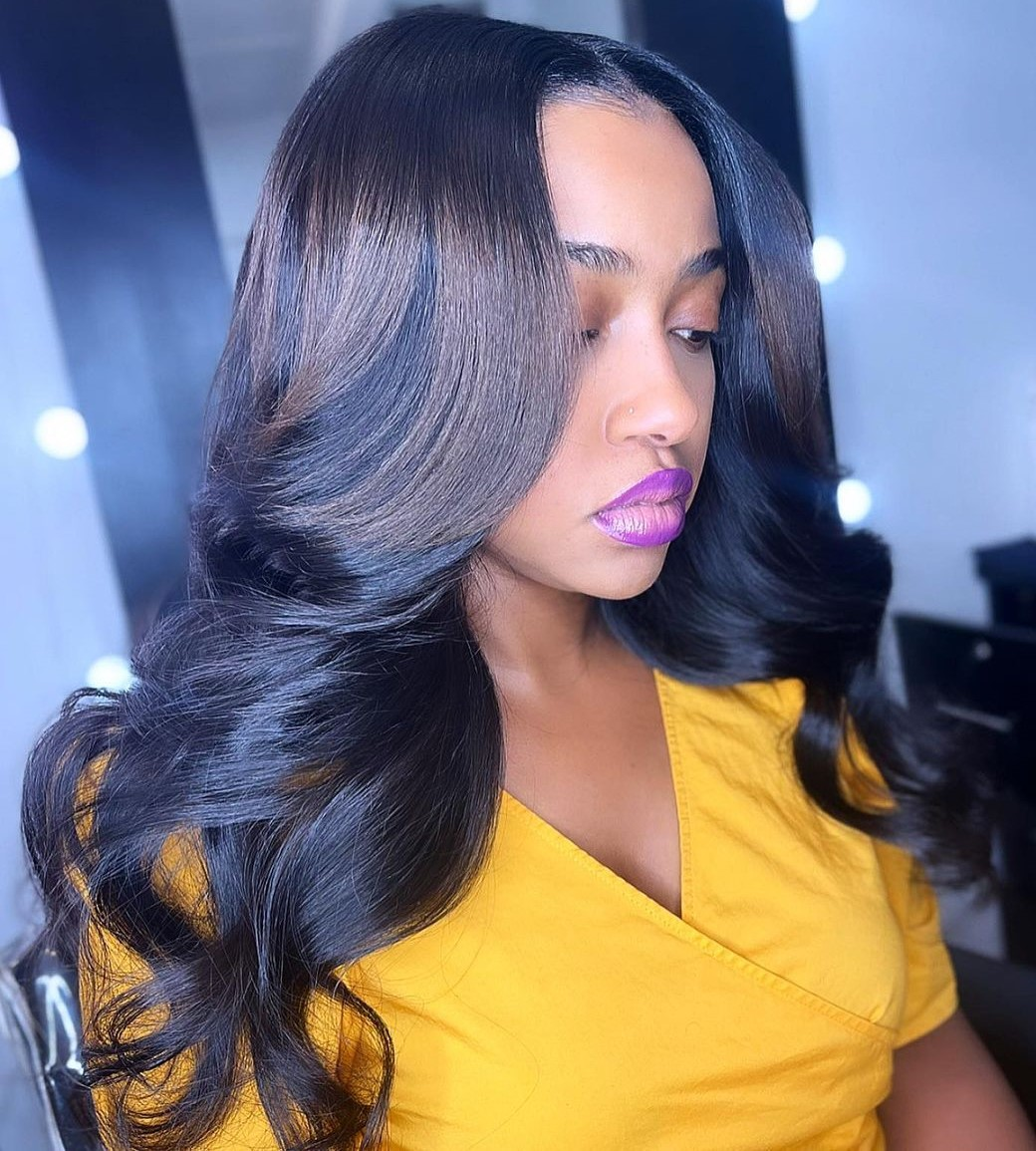 Sew In Hairstyle with a Middle Part