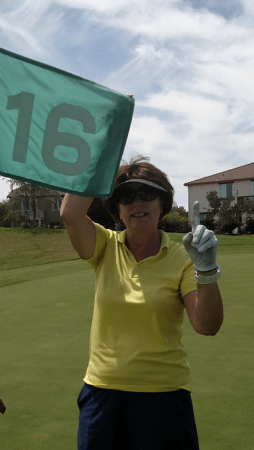Ruth Ahrens celebrates her hole-in-one at Wild Wings