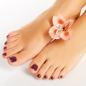Pedicured Feet With Flower