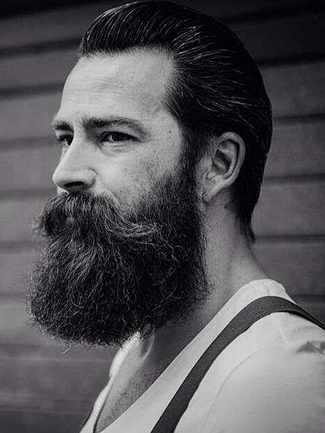 Back Slick Hairstyle With Lumberjack Beard