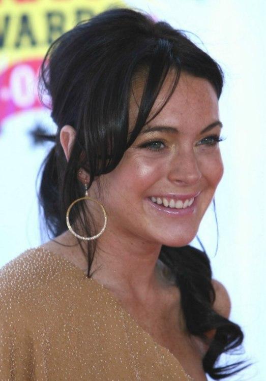 Lindsay Lohan With Dark Brunette Hair Pulled Back In Long