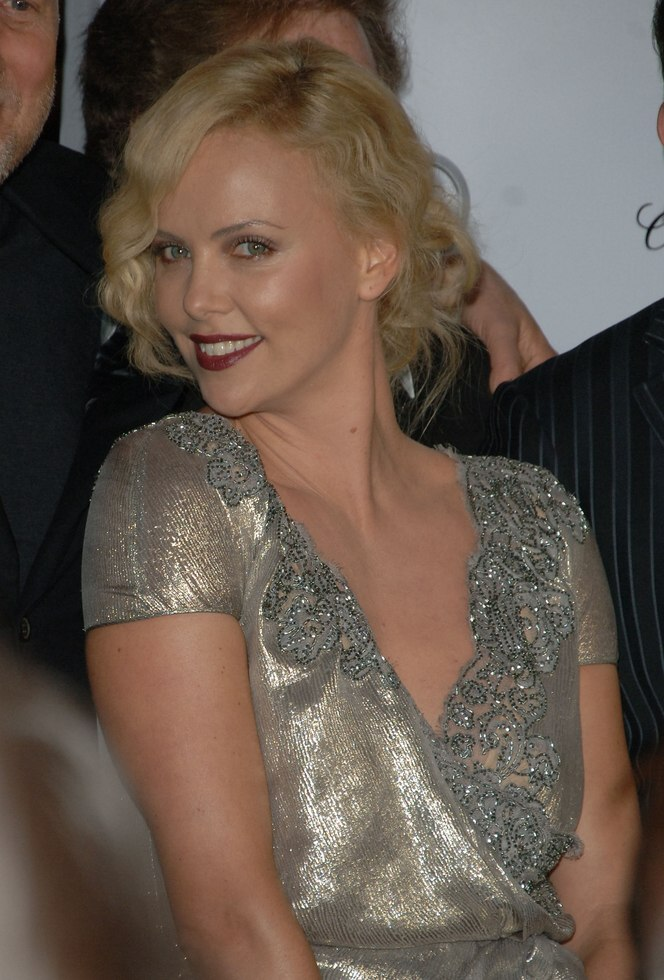 Charlize Theron Waved Hair In An Up Style For A 1930s Look