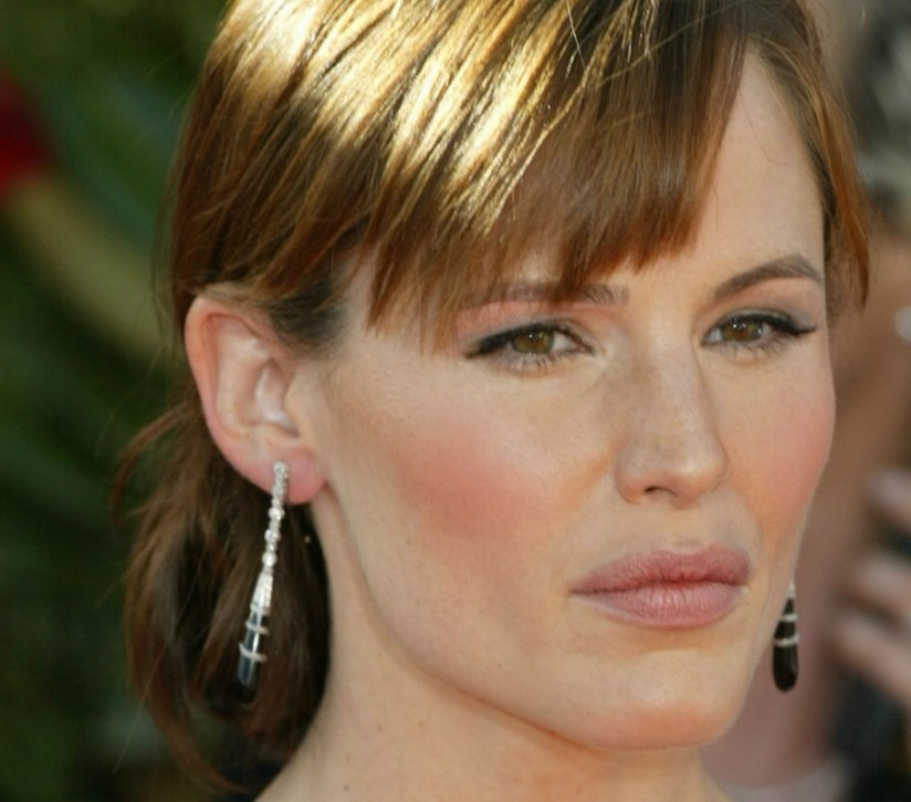 Jennifer Garner With Her Hair In An Updo With A Loose Bun