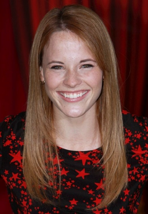 Katie Leclerc Sporting Smooth Mid Back Length Hair With