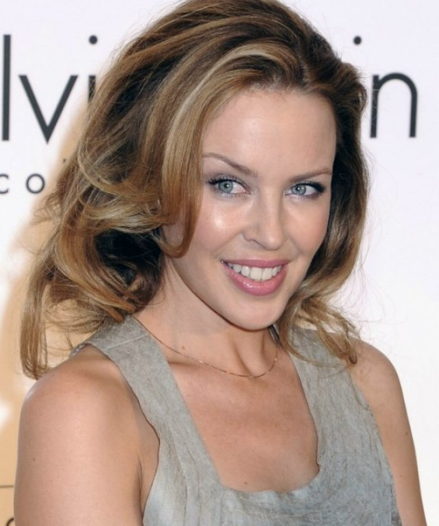 kylie minogue's long hairstyle with rolling volume