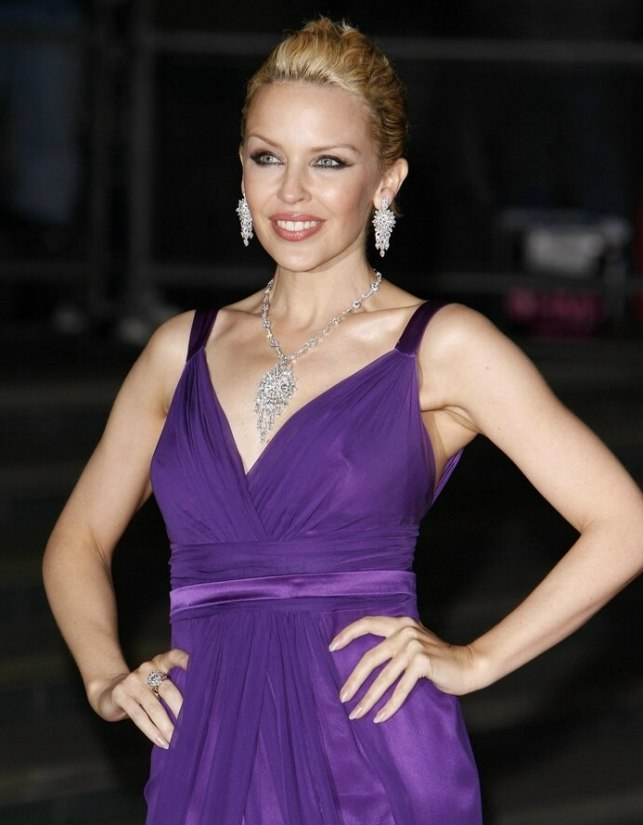 Kylie Minogue With Her Duo Toned Hair Brushed Back From