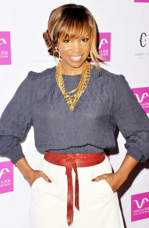 Elise Neal Updo With A Bun On The Side Of The Head