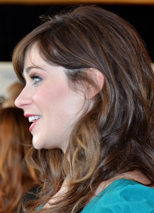 Zooey Deschanels Long Curled Hair With A Retro Feel