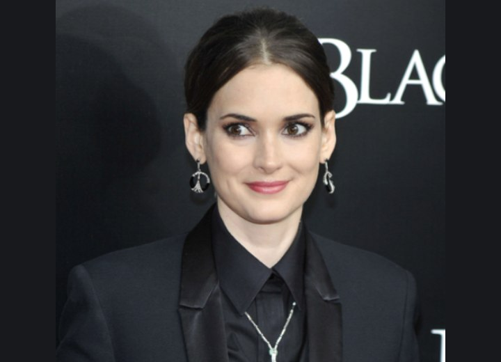 Winona Ryder Wearing Her Hair Pulled Back Into A Knot